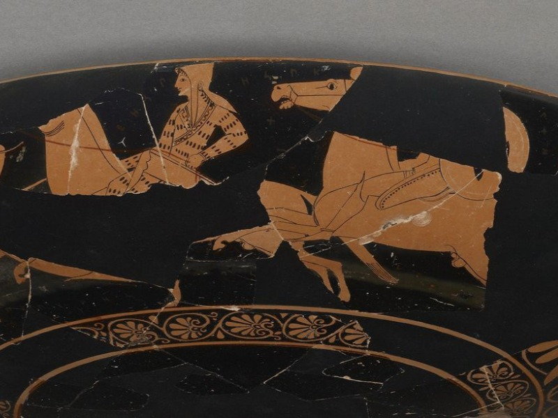 This Greek cup, dating from around 510 B.C., depicts an Amazon warrior on a horse. Scholars suggest wording on the vase names the woman Worthy of Armor in ancient Circassian.